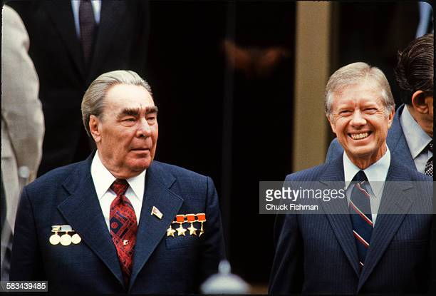 President Jimmy Carter right smiles while standing alongside Russian Communist Party General Secretary Leonid Brezhnev outside the US embassy in...