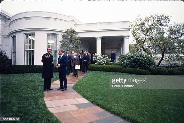 US President Jimmy Carter right speaks and walks with Egyptian President Anwar Sadat as they leave the White House after exiting the Oval Office...