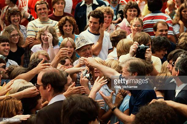 President Jimmy Carter shakes hands with a throng of Wisconsinites during a summer vacation touring the Mississippi River on the Delta Queen riverboat