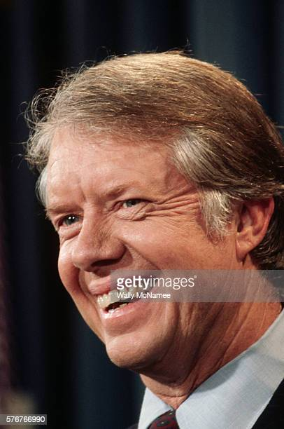 President Jimmy Carter smiles at a question during a press conference at the Old Executive Office Building