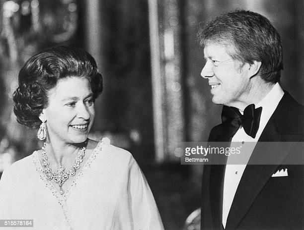 President Jimmy Carter stands with Queen Elizabeth at Buckingham Palace at a dinner for summit leaders