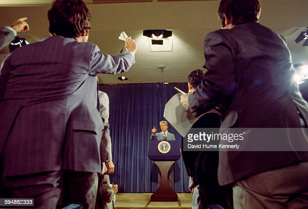 President Jimmy Carter takes questions from members of the press at a presidential news conference at the Old Executive Office Building, April 15,...