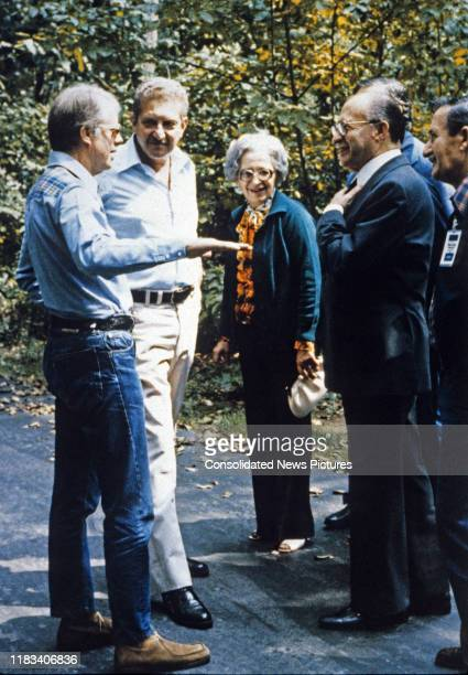 President Jimmy Carter talks with Israeli Prime Minister Menachem Begin and his party during the Egyptian-Israeli peace negotiations at Camp David,...