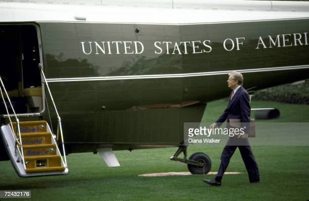 President Jimmy Carter walking towards helicopter for departure to Camp David