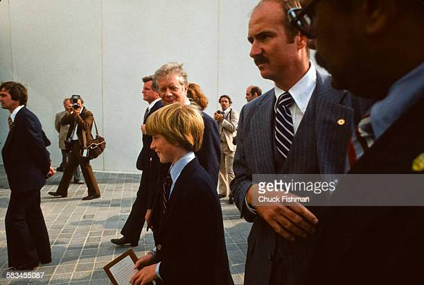 President Jimmy Carter walks alongside Patrick Kennedy son of Senator Edward Kennedy at the dedication ceremony for the John F Kennedy Presidential...