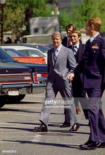 President Jimmy Carter walks to a presidential news conference at the Old Executive Office Building April 15 1977 in Washington DC