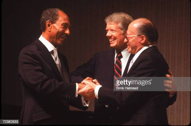 President Jimmy Carter with Egyptian President Anwar Sadat and Israeli leader Menachem Begin at MidEast peace treaty signing ceremonies