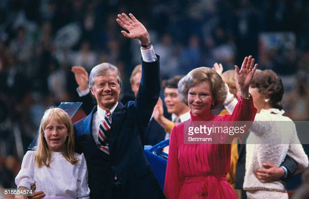 US President Jimmy Carter with his wife Rosalynn and daughter Amy wave to supporters from the stage at the 1980 Democratic National Convention