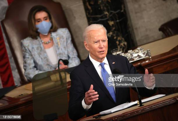 President Joe Biden addresses a joint session of congress as Speaker of the House U.S. Rep. Nancy Pelosi looks on in the House chamber of the U.S....