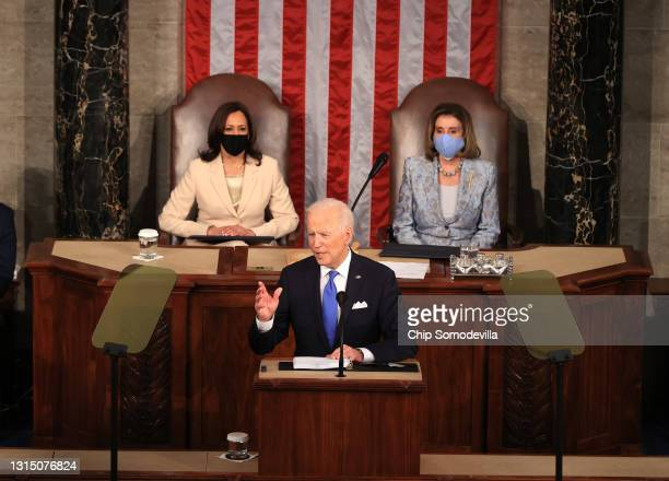 President Joe Biden addresses a joint session of congress as Vice President Kamala Harris and Speaker of the House U.S. Rep. Nancy Pelosi look on in...