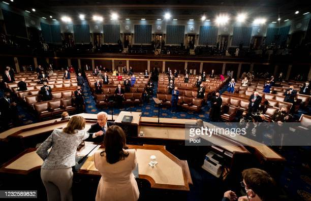 President Joe Biden addresses a Joint Session of Congress, with Speaker of the House Nancy Pelosi and Vice President Kamala Harris behind, on Capitol...