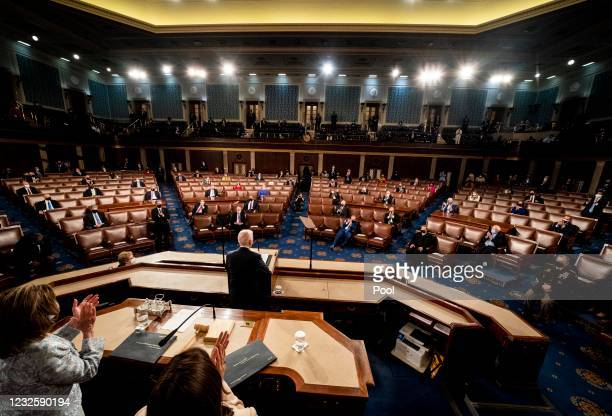President Joe Biden addresses a Joint Session of Congress, with Speaker of the House Nancy Pelosi and Vice President Kamala Harris behind on the...