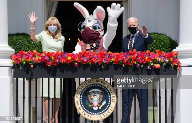 President Joe Biden, alongside First Lady Jill Biden and the Easter Bunny , wave after Biden spoke about the Easter holiday and the traditional White...