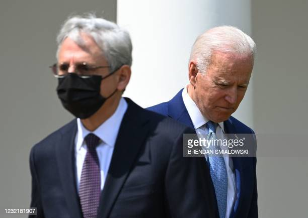 President Joe Biden and Attorney General Merrick Garland take part in an event about gun violence prevention in the Rose Garden of the White House in...