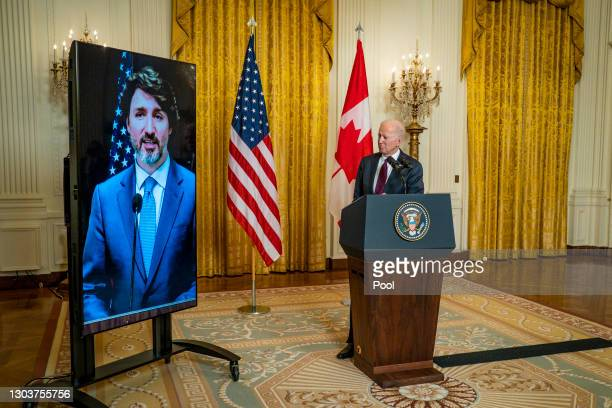 President Joe Biden and Canadian Prime Minister Justin Trudeau deliver opening statements via video link in the East Room of the White House February...