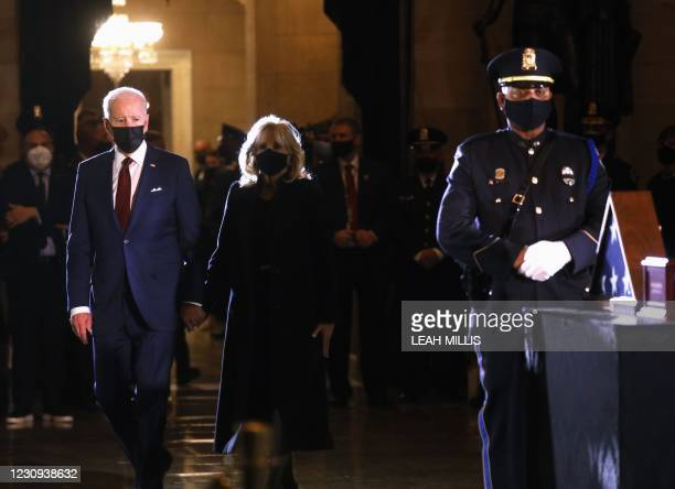 President Joe Biden and First Lady Doctor Jill Biden arrive to pay their respects to US Capitol Police Officer Brian Sicknick, as he lies in honor in...