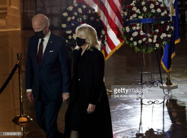 President Joe Biden and First Lady Doctor Jill Biden leave after paying their respects to US Capitol Police Officer Brian Sicknick, as he lies in...
