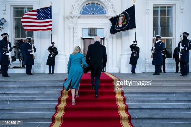 President Joe Biden and first lady Dr. Jill Biden arrive at the North Portico of the White House, on January 20 in Washington, DC. During today's...