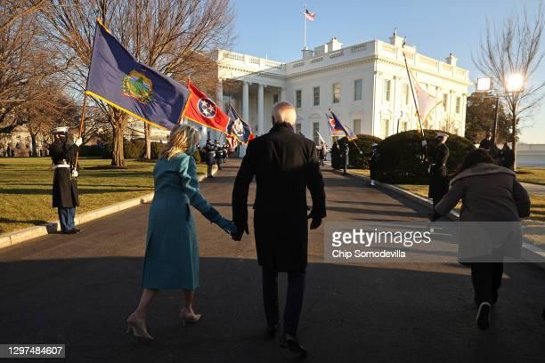 President Joe Biden and First Lady Dr. Jill Biden arrive at the White House after Biden's inauguration on January 20, 2021 in Washington, DC. Biden...
