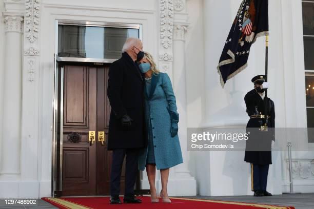 President Joe Biden and First Lady Dr. Jill Biden embrace at the White House after Biden's inauguration on January 20, 2021 in Washington, DC. Biden...