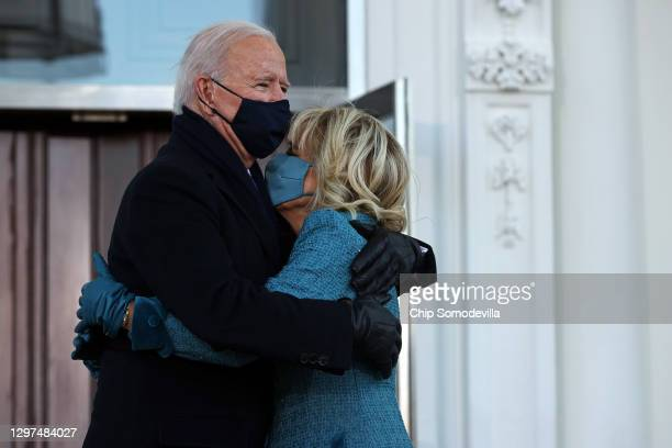 President Joe Biden and First Lady Dr. Jill Biden embrace while standing at the North Portico of The White House after Biden's inauguration on...