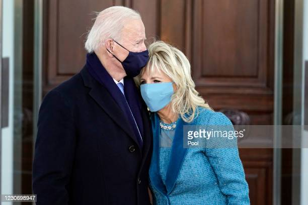 President Joe Biden and first lady Dr. Jill Biden hug as they arrive at the North Portico of the White House, on January 20 in Washington, DC. During...