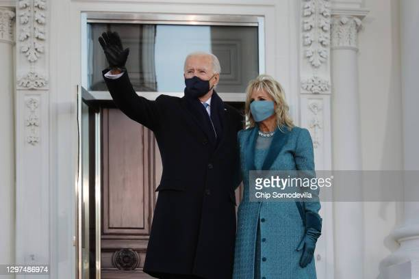 President Joe Biden and First Lady Dr. Jill Biden pose for photographs on the North Portico of the White House following his inauguration on January...