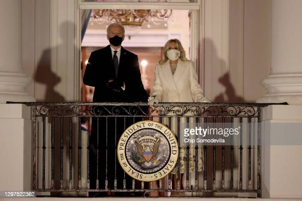 President Joe Biden and First Lady Dr. Jill Biden prepare to watch fireworks at the White House on January 20, 2021 in Washington, DC. Biden became...