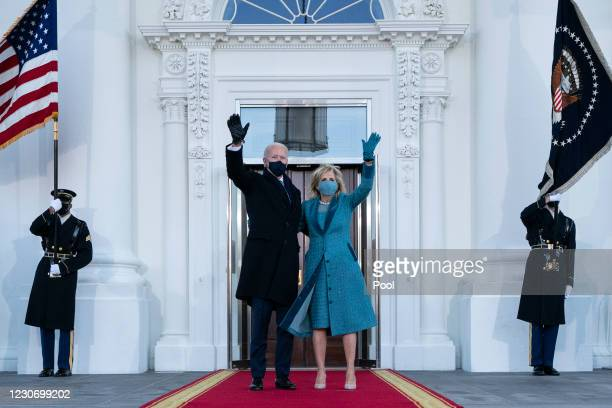 President Joe Biden and first lady Dr. Jill Biden wave as they arrive at the North Portico of the White House, on January 20 in Washington, DC....