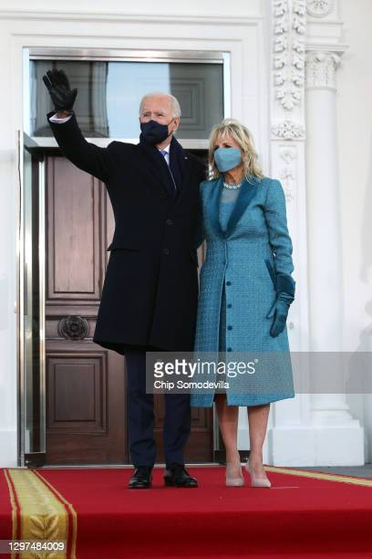 President Joe Biden and First Lady Dr. Jill Biden wave while standing at the North Portico of The White House after Biden's inauguration on January...
