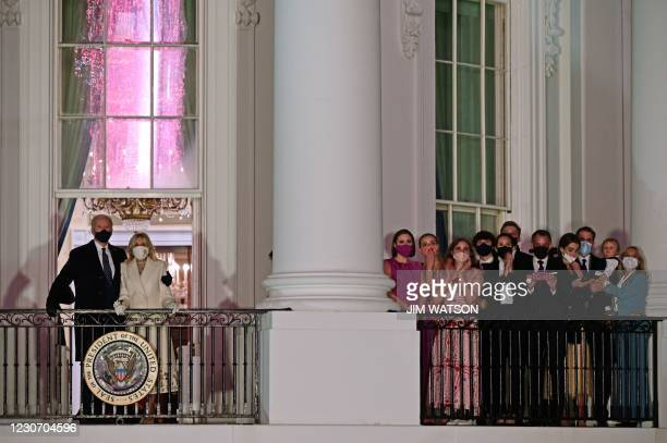 President Joe Biden and First Lady Jill Biden appear on the Blue Room Balcony as they and family members watch fireworks from the White House in...