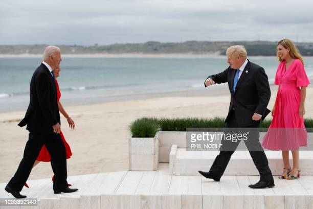 President Joe Biden and First Lady Jill Biden are welcomed by Britain's Prime Minister Boris Johnson and his wife Carrie Johnson as they arrive for...