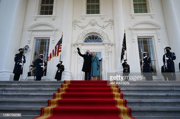 President Joe Biden and First Lady Jill Biden arrive at the White House in Washington, DC, on January 20, 2021.