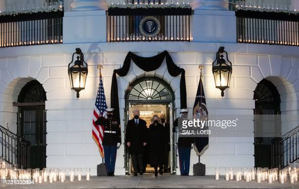 President Joe Biden and First Lady Jill Biden arrive to hold a moment of silence during a candelight ceremony in honor of those who lost their lives...