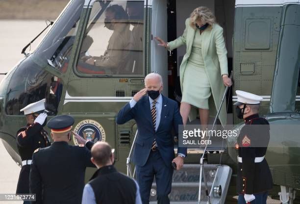President Joe Biden and First Lady Jill Biden disembark from Marine One after arriving at Delaware Air National Guard Base in Wilmington, Delaware,...