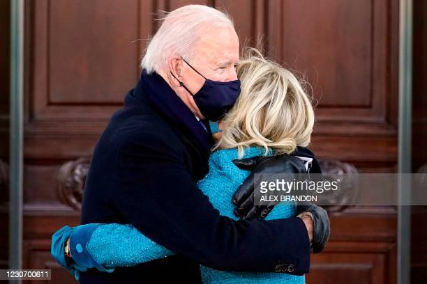 President Joe Biden and First Lady Jill Biden embrace as they arrive at the North Portico of the White House,on January 20, 2021 in Washington, DC.