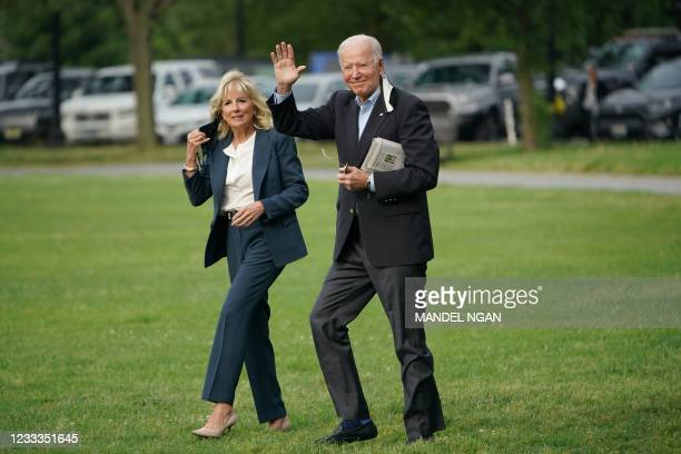 President Joe Biden and First Lady Jill Biden make their way to board Marine One before departing from the Ellipse, near the White House, in...