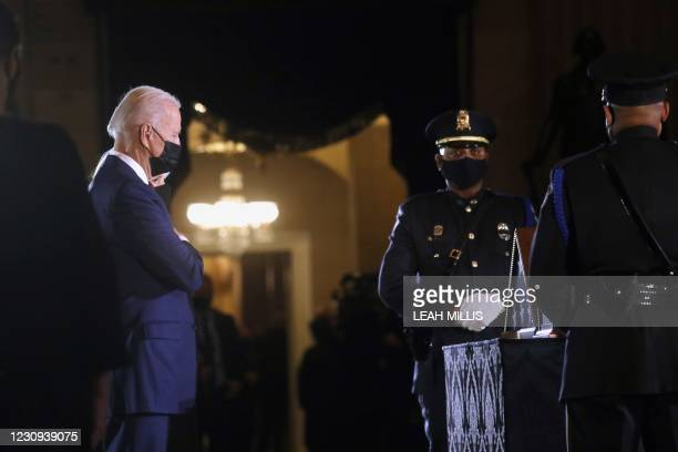 President Joe Biden and First Lady Jill Biden pay their respects to late US Capitol Police officer Brian Sicknick, as he lies in honor in the Capitol...