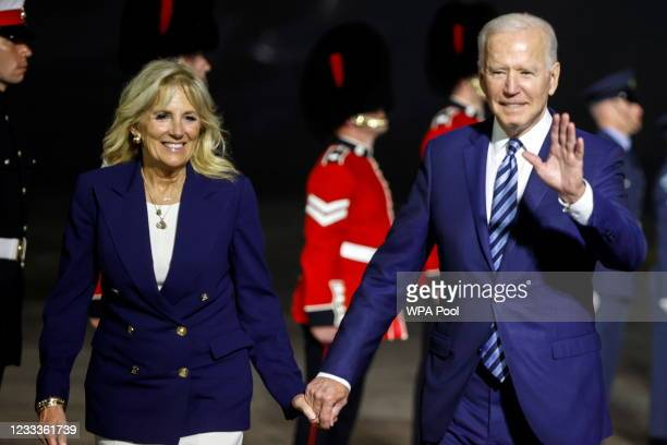 President Joe Biden and first lady Jill Biden react upon arrival at Cornwall Airport on June 9, 2021 near Newquay, Cornwall, England. On June 11,...