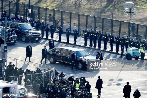 President Joe Biden and First Lady Jill Biden ride in the presidential limousine along 15th St. During the 59th presidential inauguration parade on...