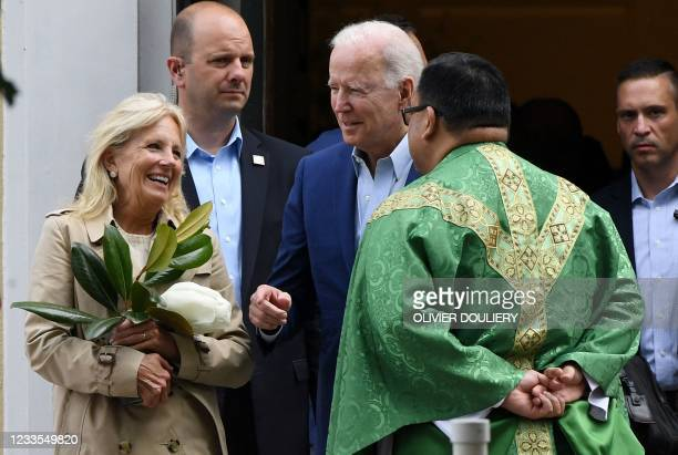 President Joe Biden and First Lady Jill Biden speaks with a priest as they leave St. Joseph on the Brandywine Catholic Church in Wilmington,...