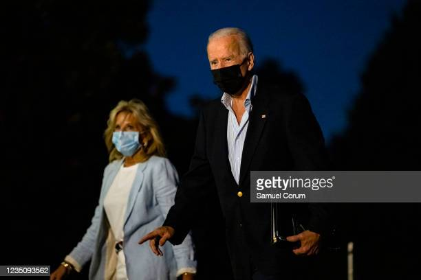 President Joe Biden and First Lady Jill Biden walk across the South Lawn as they head into the White House on September 6, 2021 in Washington, DC....