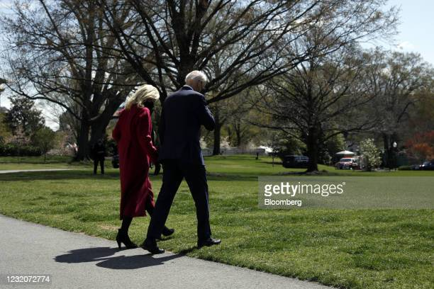 President Joe Biden and First Lady Jill Biden walk on the South Lawn of the White House before boarding Marine One in Washington, D.C., U.S., on...