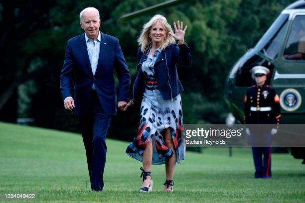 President Joe Biden and first lady Jill Biden walk on the South Lawn of the White House on July 18, 2021 in Washington, DC. The Bidens were returning...