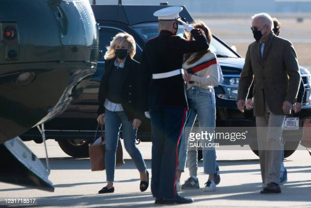 President Joe Biden and First Lady Jill Biden walk to board Marine One prior to departing from Delaware Air National Guard Base in Wilmington,...