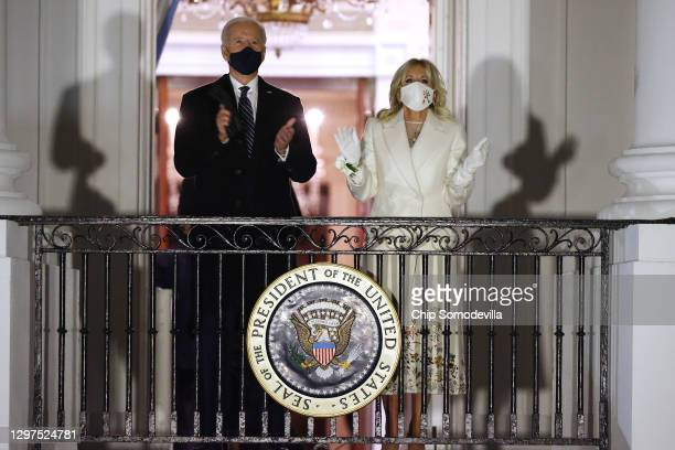 President Joe Biden and first lady Jill Biden watch a fireworks show on the National Mall from the Truman Balcony at the White House January 20, 2021...