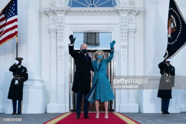 President Joe Biden and First Lady Jill Biden wave as they arrive at the White House in Washington, DC, on January 20, 2021.
