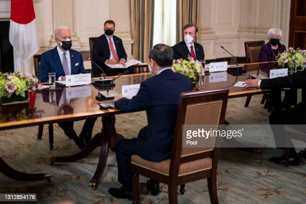 President Joe Biden and Japanese Prime Minister Yoshihide Suga hold a bilateral meeting in the State Dining Room at the White House April 16, 2021 in...