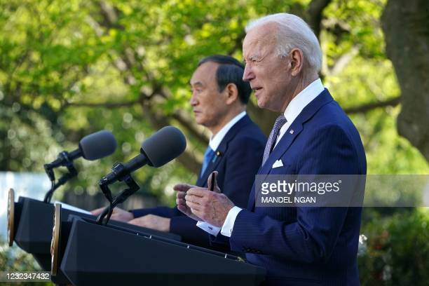 President Joe Biden and Japan's Prime Minister Yoshihide Suga take part in a joint press conference in the Rose Garden of the White House in...
