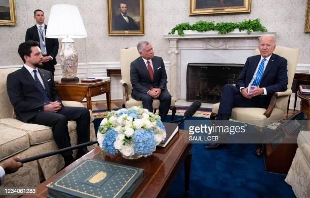 President Joe Biden and Jordan's King Abdullah II, alongside Jordan's Crown Prince Hussein bin Abdullah II , hold a meeting in the Oval Office of the...